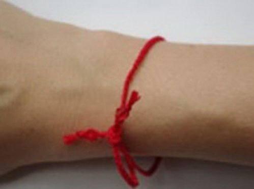 Как завязать и носить красную нить